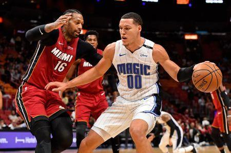 Dec 4, 2018; Miami, FL, USA; Orlando Magic forward Aaron Gordon (00) controls the ball around Miami Heat forward James Johnson (16) during the first half at American Airlines Arena. Mandatory Credit: Jasen Vinlove-USA TODAY Sports