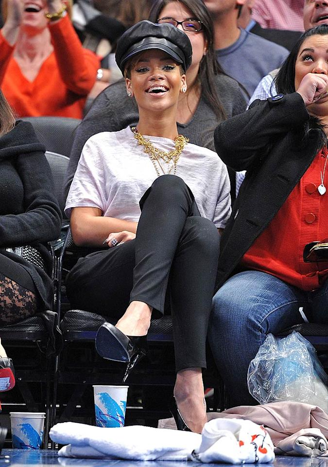 """Rihanna takes a break from promoting her new album <i>Rated R</i>, opting instead for some G-rated entertainment with courtside seats at the New York Knicks game at Madison Square Garden. The Knicks won 93-84 over the Portland Trailblazers. James Devaney/<a href=""""http://www.wireimage.com"""" target=""""new"""">WireImage.com</a> - December 7, 2009"""