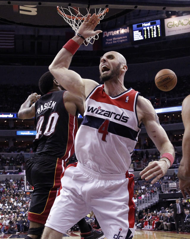 Washington Wizards center Marcin Gortat (4), from Poland, reacts after a blocked shot by Miami Heat forward Udonis Haslem (40) in the second half of an NBA basketball game, Monday, April 14, 2014, in Washington. The Wizards won 114-93. (AP Photo/Alex Brandon)