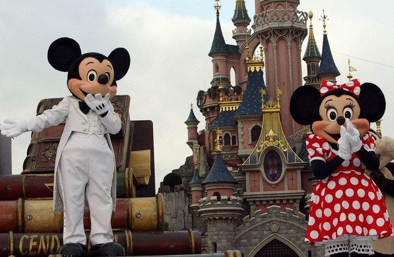 Euro Disney employees wearing Mickey Mouse and Minnie costumes. (File photo: AFP)
