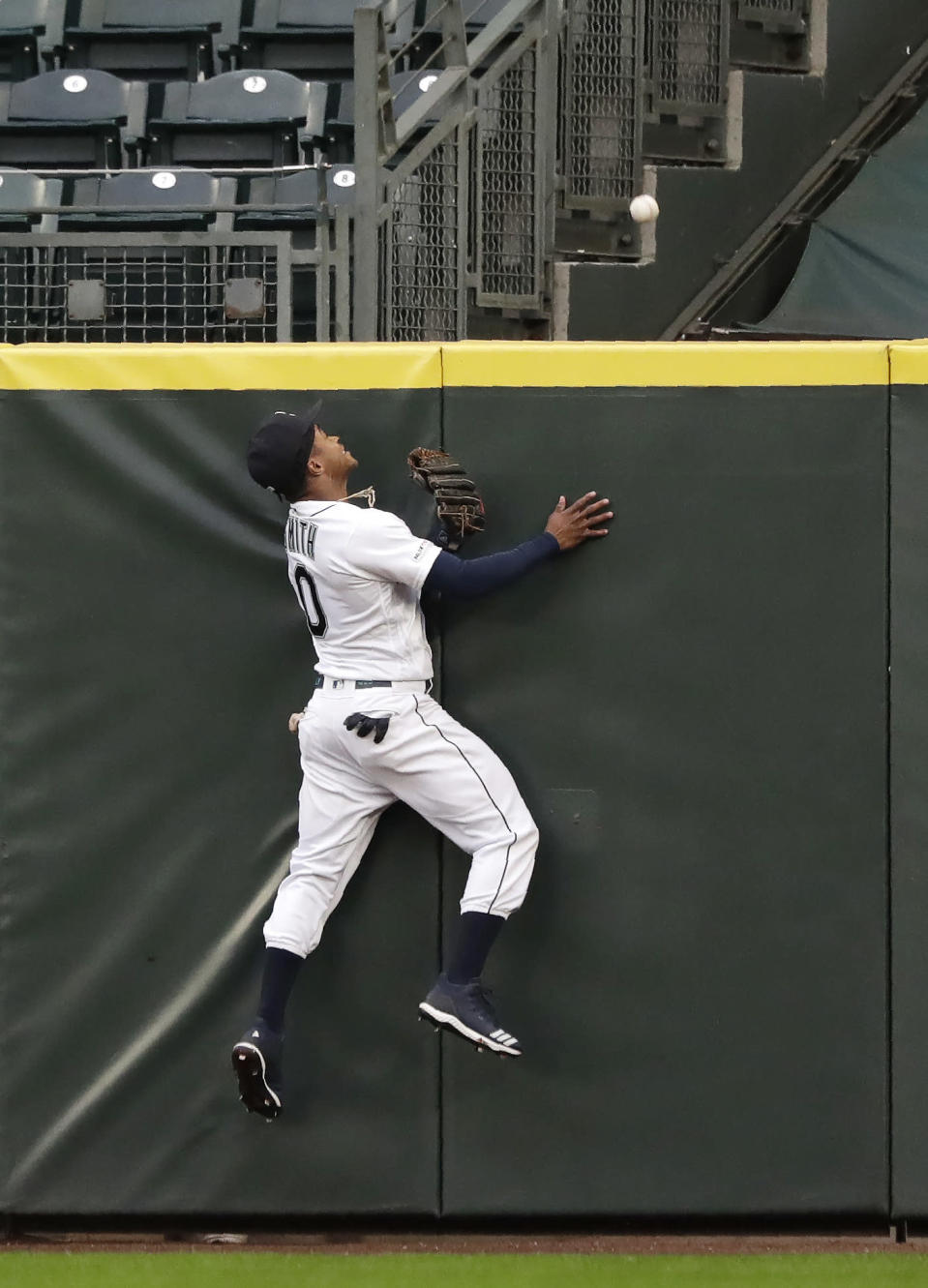 CORRECT STHAT HOME RUN WAS BY JORGE SOLER IN THE THIRD INNING - Seattle Mariners center fielder Mallex Smith leaps at the wall but is unable to catch a home run by Kansas City Royals' Jorge Soler during the third inning of a baseball game Tuesday, June 18, 2019, in Seattle. (AP Photo/Elaine Thompson)