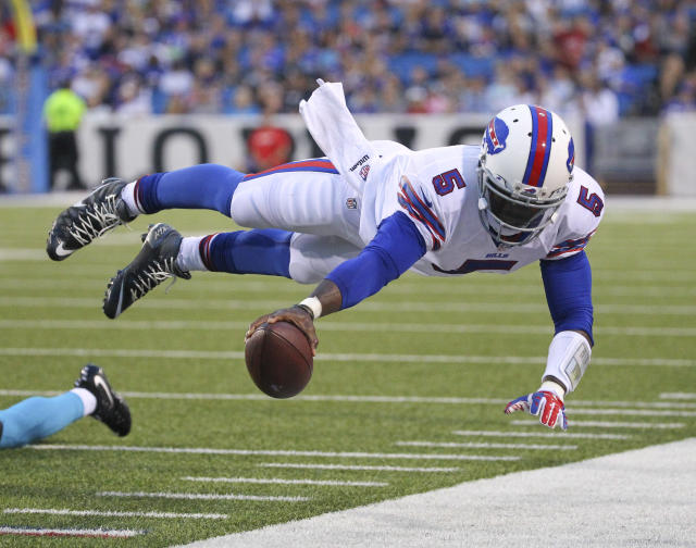 FILE - In this Aug. 15, 2015 file photo, Buffalo Bills quarterback Tyrod Taylor (5) dives for the first down marker during the first half of an NFL preseason football game against the Carolina Panthers in Orchard Park, N.Y. Two people familiar with the trade said Friday, March 9, 2018, the Cleveland Browns have agreed to acquire Taylor from the Bills for a third-round draft pick this year. (AP Photo/Bill Wippert, File)