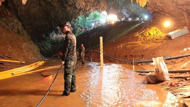 PHOTO: Thai rescue teams arrange a water pumping system at the entrance to a flooded cave complex where 12 boys and their soccer coach have been trapped since June 23, in Mae Sai, Chiang Rai province, northern Thailand in this undated photo. (Royal Thai Navy via AP)