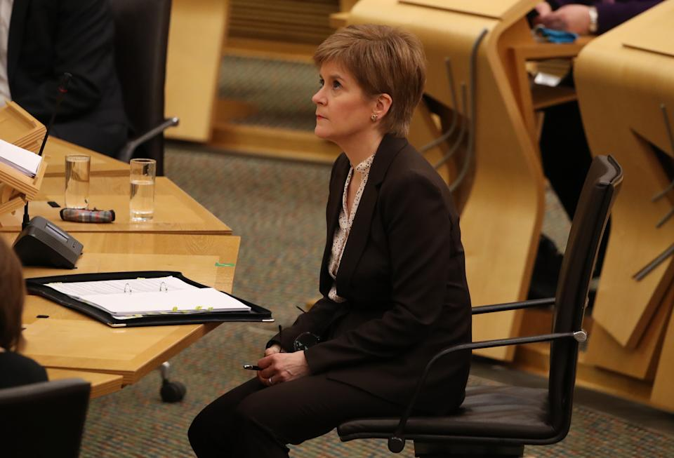 First Minister Nicola Sturgeon reacts as she delivers a statement at Holyrood, Edinburgh, announcing that Scotland will be placed in lockdown from midnight for the duration of January with a legal requirement to stay at home except for essential purposes.