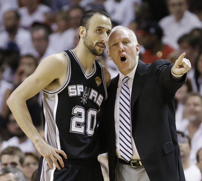 The San Antonio Spurs' Manu Ginobili (20) speaks with head coach Gregg Popovich during the first half in Game 7 of the NBA basketball championships against the Miami Heat, Thursday, June 20, 2013, in Miami. (AP Photo/Lynne Sladky)