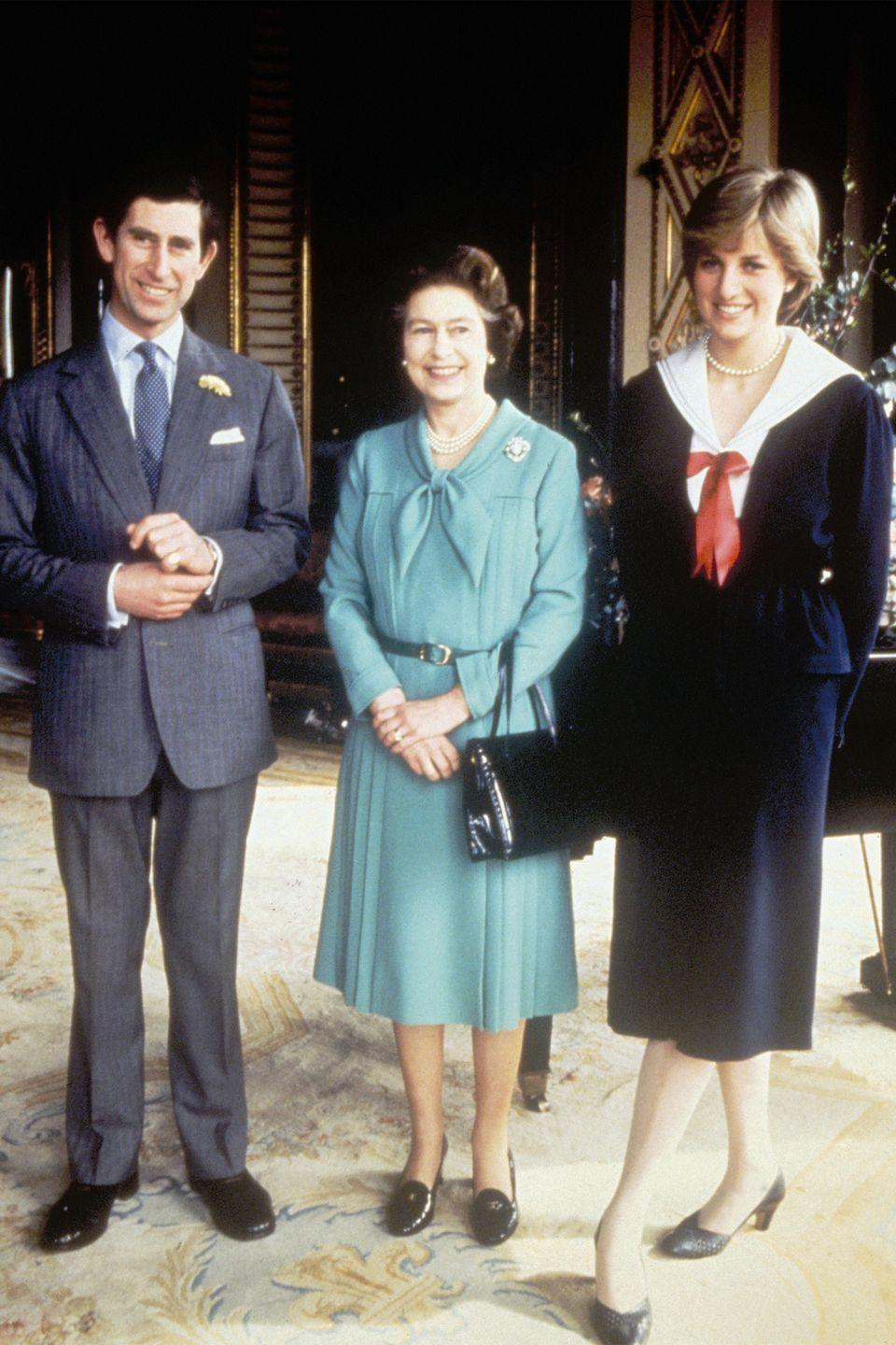 <p>The queen posed with her son Prince Charles and his then-fiancee Lady Diana Spencer at Buckingham Palace.</p>