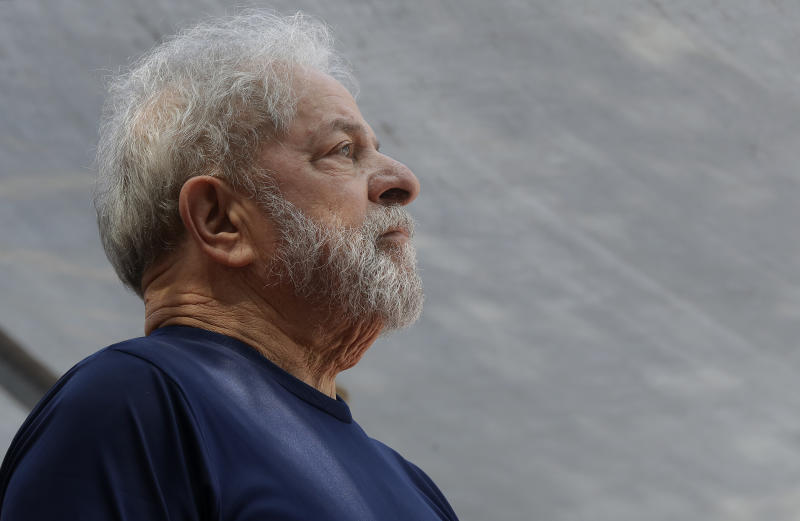 Brazilian former President Luiz Inacio Lula da Silva looks on prior to delivering a speech outside the Metal Workers Union headquarters in Sao Bernardo do Campo, Brazil, Saturday, April 7, 2018. Da Silva told supporters he will comply with an arrest warrant and turn himself in to police, to begin serving a sentence of 12 years and one month for a corruption conviction. (AP Photo/Andre Penner)