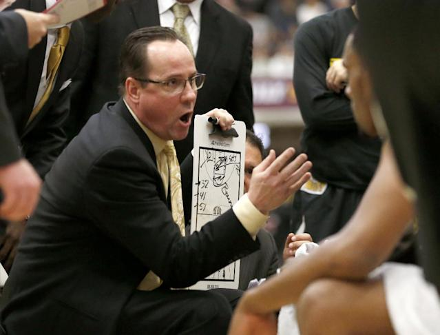 Wichita State head coach Gregg Marshall directs his team during the second half of an NCAA college basketball game against Loyola of Chicago Wednesday, Feb. 19, 2014, in Chicago. Wichita State won 88-74. (AP Photo/Charles Rex Arbogast)