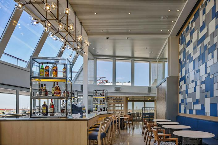 bar with seating surrounded by a glass wall