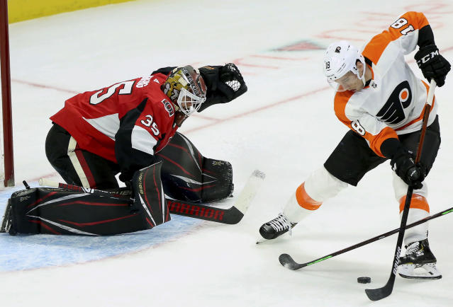Philadelphia Flyers center Tyler Pitlick (18) tries a backhand shot on Ottawa Senators goaltender Marcus Hogberg (35) during the second period of an NHL hockey game, Saturday, Dec. 21, 2019, in Ottawa, Ontario. (Fred Chartrand/The Canadian Press via AP)