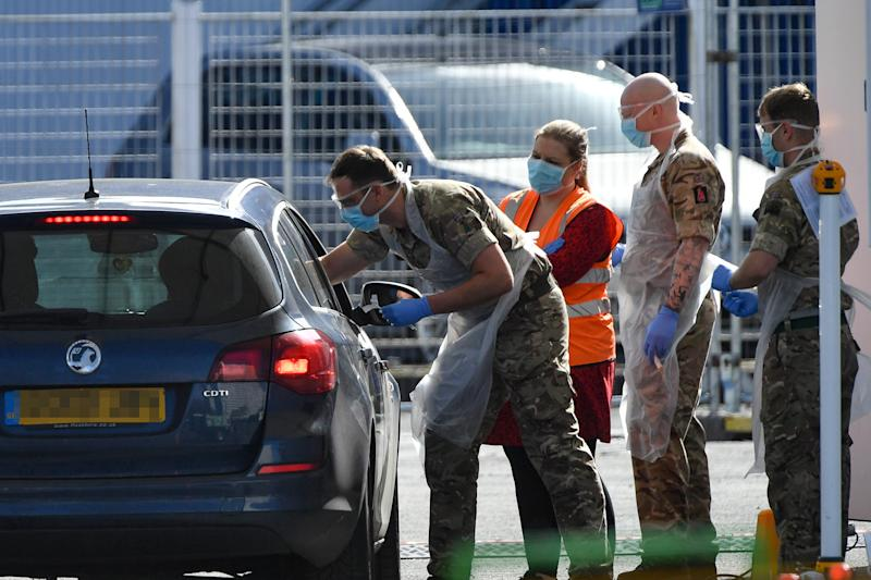 EDITORS NOTE: NUMBER PLATE PIXELATED BY PA PICTURE DESK Picture taken at 1045am of Military personnel help administer Covid19 tests for NHS workers at Edgbaston cricket ground in Birmingham, as the UK continues in lockdown to help curb the spread of the coronavirus.