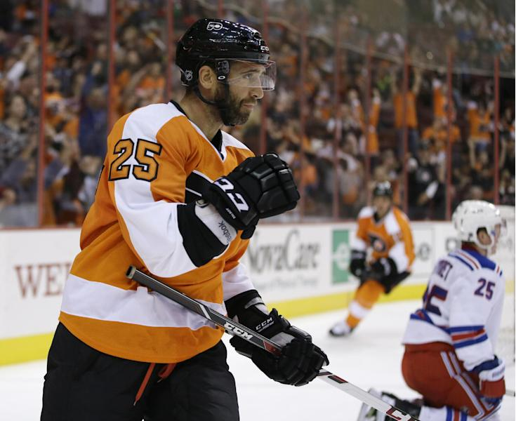 Philadelphia Flyers' Maxime Talbot, left, reacts after scoring a goal against the New York Rangers during the second period of a preseason NHL hockey game, Tuesday, Sept. 17, 2013, in Philadelphia. (AP Photo/Matt Slocum)