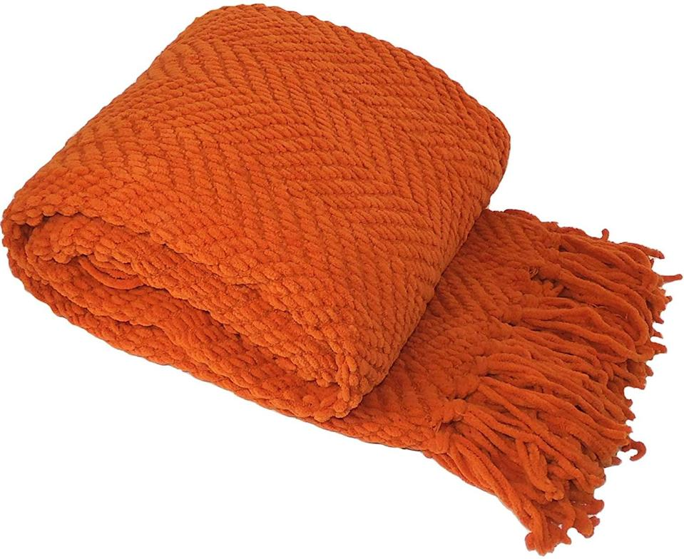 <p>If you love orange, get this <span>Home Soft Things Knitted Tweed Throw Couch Cover Blanket</span> ($34).</p>