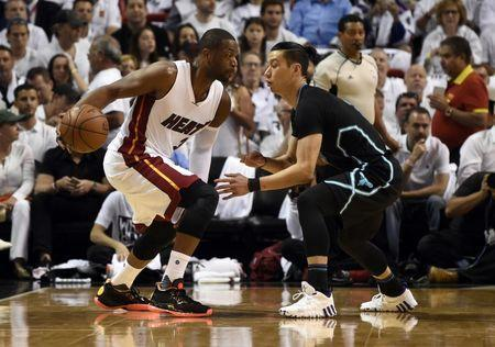 May 1, 2016; Miami, FL, USA; Miami Heat guard Dwyane Wade (3) is pressured by Charlotte Hornets guard Jeremy Lin (7) during the first half in game seven of the first round of the NBA Playoffs at American Airlines Arena. Mandatory Credit: Steve Mitchell-USA TODAY Sports / Reuters Picture Supplied by Action Images