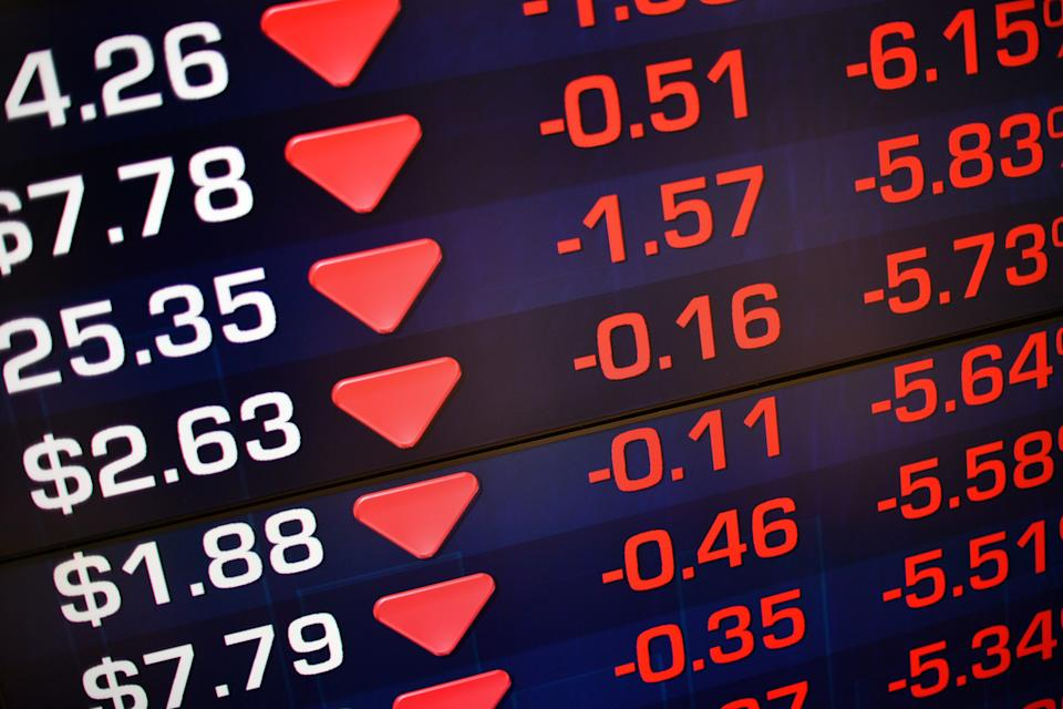 A screen at the Australian Securities Exchange (ASX) displays losses in early trading in Sydney on February 6, 2018. Australian stocks slumped 2.58 percent at the open on February 6 as they followed the lead of Wall Street which endured a brutal session with one of its steepest ever one-day point drops. / AFP PHOTO / SAEED KHAN        (Photo credit should read SAEED KHAN/AFP via Getty Images)