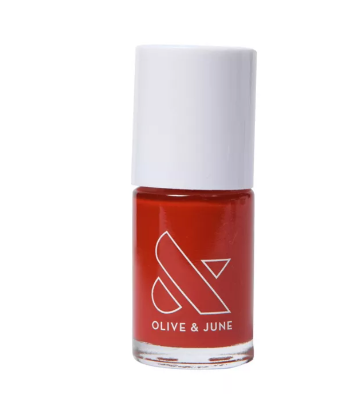 """<p><strong>Olive & June</strong></p><p>target.com</p><p><strong>$8.00</strong></p><p><a href=""""https://www.target.com/p/olive-38-june-nail-polish-0-46-fl-oz/-/A-79576361"""" rel=""""nofollow noopener"""" target=""""_blank"""" data-ylk=""""slk:Shop Now"""" class=""""link rapid-noclick-resp"""">Shop Now</a></p><p>This isn't your traditional holiday red, but its warm undertones look great unwrapping gifts and sneaking into stockings. </p>"""