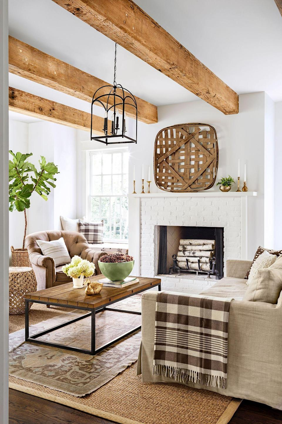 """<p>Come fall, you might be inclined to decorate with layers of texture, transition your home's color palette from energetic hues to earth tones, and even <a href=""""https://www.goodhousekeeping.com/home/g30224103/11-relaxing-and-cozy-reading-corner-ideas/"""" rel=""""nofollow noopener"""" target=""""_blank"""" data-ylk=""""slk:carve out a cozy nook"""" class=""""link rapid-noclick-resp"""">carve out a cozy nook</a> that's perfect for lounging. Autumn presents an opportunity to make the most of more time spent indoors, which means finding ways to <a href=""""https://www.goodhousekeeping.com/home/decorating-ideas/g2716/fall-decorations/"""" rel=""""nofollow noopener"""" target=""""_blank"""" data-ylk=""""slk:make your home more cozy"""" class=""""link rapid-noclick-resp"""">make your home more cozy</a> and welcoming. Believe it or not, this doesn't mean you have to blow your budget. One of the best places to start? Your living room mantel. </p><p>Fall mantel decorating is all about being creative, whether you choose to bring in the outdoors by incorporating foliage or stick to classic accessories like <a href=""""https://www.goodhousekeeping.com/holidays/halloween-ideas/g1714/no-carve-pumpkin-decorating/"""" rel=""""nofollow noopener"""" target=""""_blank"""" data-ylk=""""slk:vibrant pumpkins"""" class=""""link rapid-noclick-resp"""">vibrant pumpkins</a> and candles. Browse some of our favorite fall mantel decor ideas that showcase the beauty of the season. </p>"""