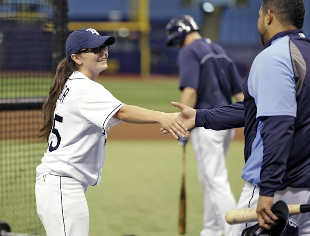 Chelsea Baker, a junior knuckleball pitcher on the Durant, Fla., High School boys baseball team, shakes hands with Tampa Bay Rays catcher Jose Molina after throwing batting practice to members of the Rays before an interleague baseball game against the Pittsburgh Pirates Monday, June 23, 2014, in St. Petersburg, Fla. (AP Photo/Chris O'Meara)
