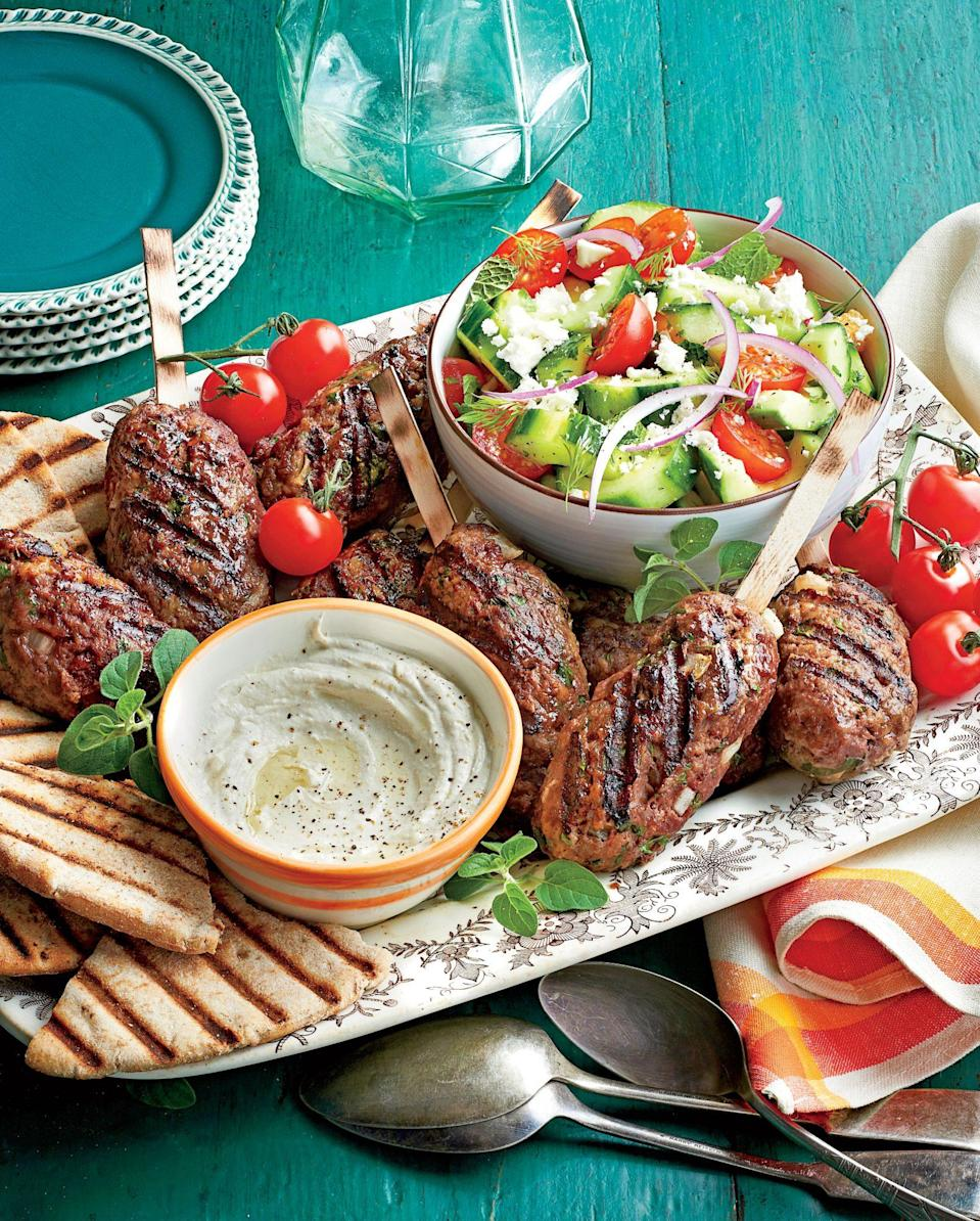 """<p><strong>Recipe:</strong> <a href=""""https://www.southernliving.com/recipes/cucumber-tomato-salad"""" rel=""""nofollow noopener"""" target=""""_blank"""" data-ylk=""""slk:Herbed Cucumber-and-Tomato Salad"""" class=""""link rapid-noclick-resp"""">Herbed Cucumber-and-Tomato Salad</a></p> <p>This Greek-inspired side dish goes with just about anything and will be the unforgettable addition to your backyard barbecue lineup.</p>"""