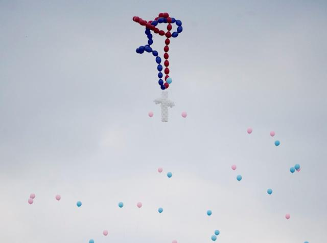 Balloons are released during a funeral service for members of the Holcombe family in Texas onNov. 15.