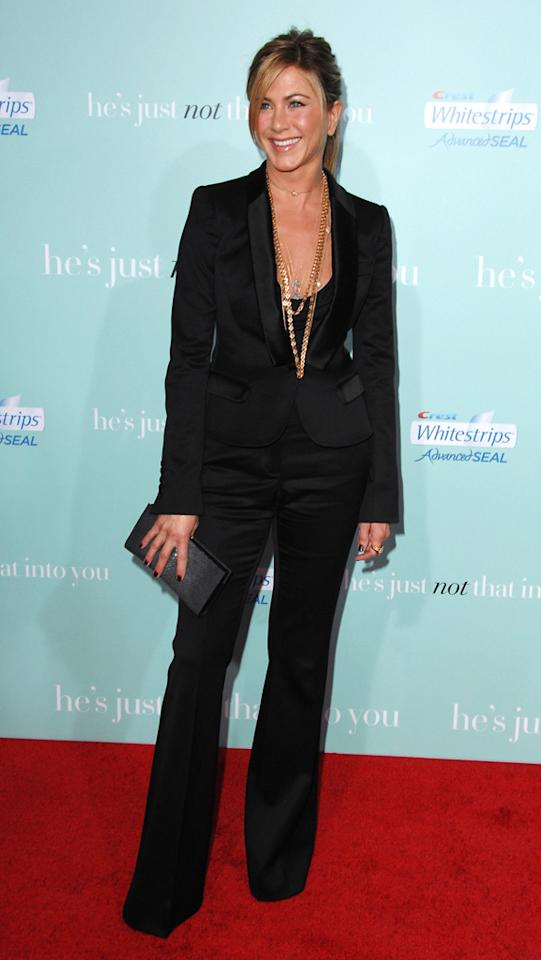 """<a href=""http://movies.yahoo.com/movie/1809932969/info"">He's Just Not That Into You</a>"" LA Premiere (2009)    We're into this perfectly tailored Burberry pantsuit. Aniston layers the look with chunky necklaces, and surprises even further by wearing her hair in a ponytail, keeping the outfit just girlie enough."
