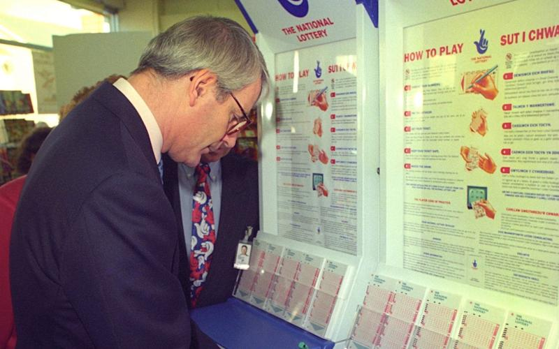 John Major was encouraged to be seen buying a lottery ticket - but aides feared embarrassment if he won - PA Archive
