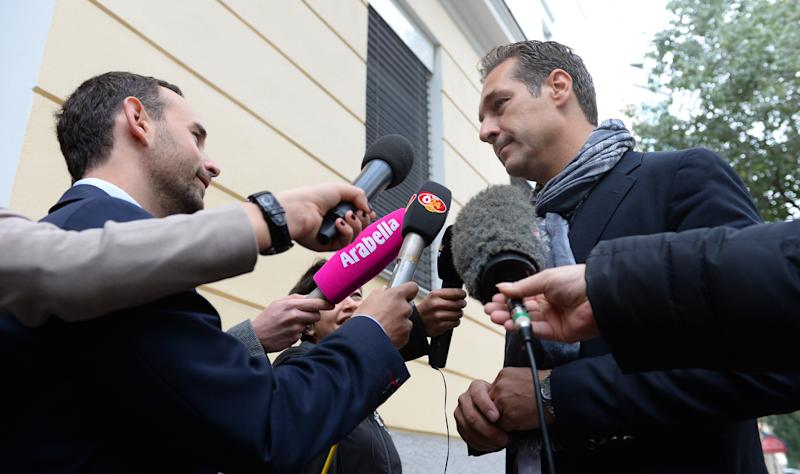 Top candidate of the Freedom Party, FPOE, Heinz-Christian Strache speaks to media on his way to cast his vote in national elections in Vienna, Austria, Sunday, Sept. 29, 2013. Austrians went to the polls to elect a new parliament. (AP Photo/Kerstin Joensson)