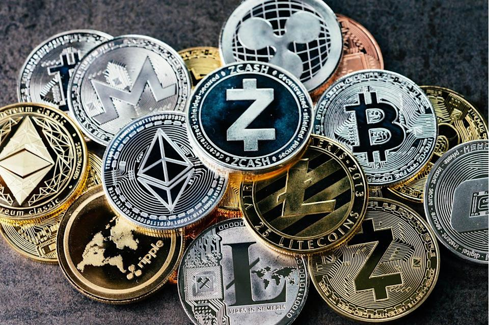 """<span class=""""attribution""""><a class=""""link rapid-noclick-resp"""" href=""""https://www.shutterstock.com/es/image-photo/crypto-currency-background-various-shiny-silver-1434643079"""" rel=""""nofollow noopener"""" target=""""_blank"""" data-ylk=""""slk:Shutterstock / eamesBot"""">Shutterstock / eamesBot</a></span>"""