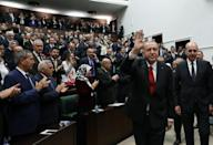 Turkish President Tayyip Erdogan greets members of parliament from his ruling AK Party as he arrives a meeting at the Turkish parliament in Ankara