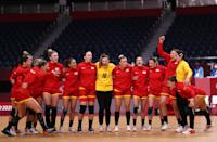 <p>Team Montenegro cheer after their national anthem ahead of the Women's Preliminary Round Group A handball match between Montenegro and South Korea on day eight of the Tokyo 2020 Olympic Games at Yoyogi National Stadium on July 31, 2021 in Tokyo, Japan. (Photo by Dean Mouhtaropoulos/Getty Images)</p>