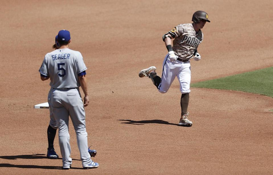 San Diego's Jake Cronenworth rounds the bases after hitting a home run in the fourth inning Sunday.