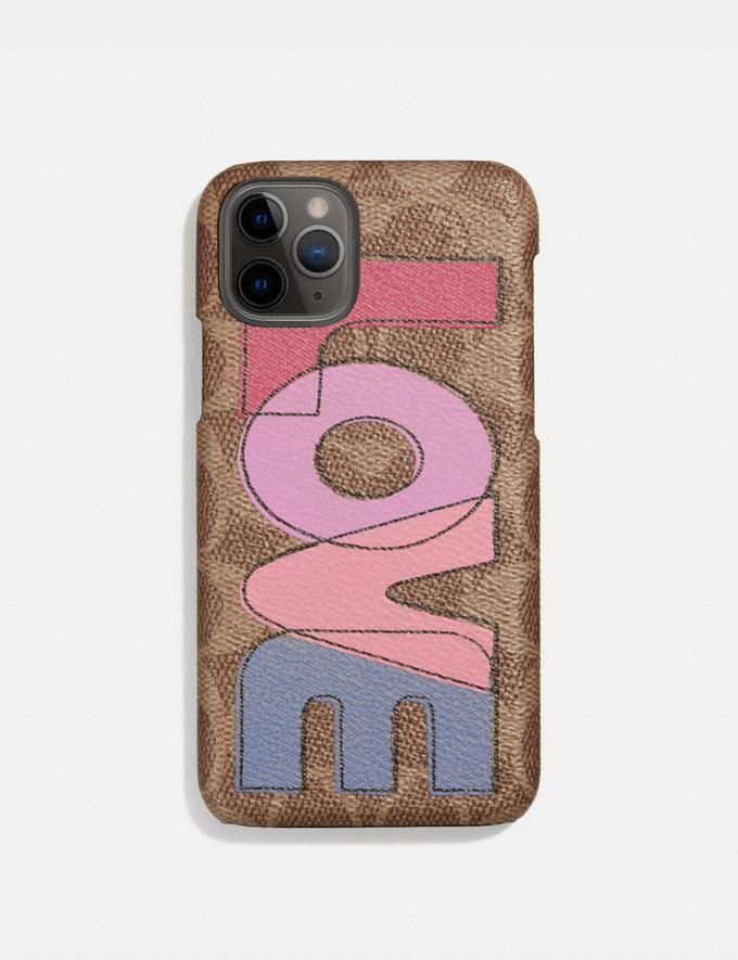 Iphone 11 Pro Case In Signature Canvas With Love Print. Image via Coach.
