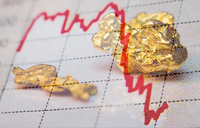 A red line moving downward, with gold nuggets in the background.