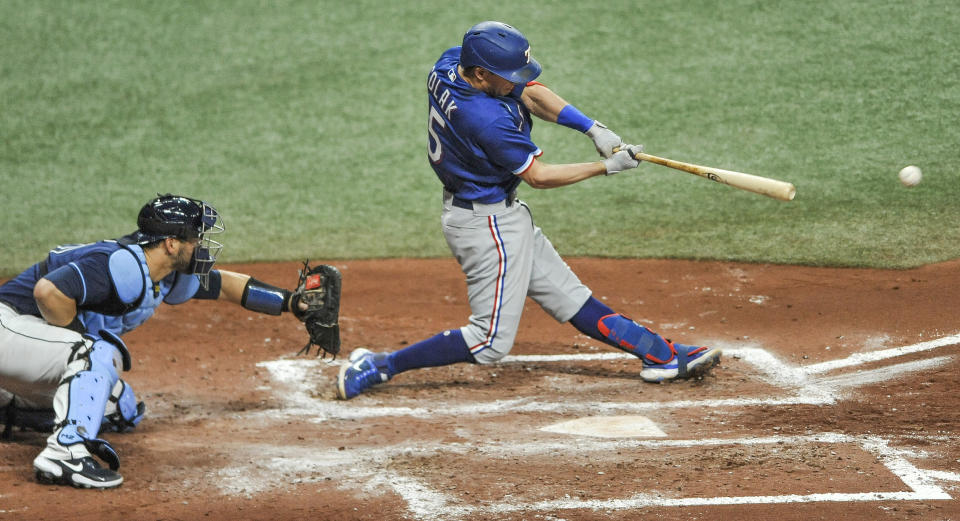 Tampa Bay Rays catcher Mike Zunino watches as Texas Rangers' Nick Solak, right, hits a three-run double during the fourth inning of a baseball game Tuesday, April 13, 2021, in St. Petersburg, Fla. (AP Photo/Steve Nesius)