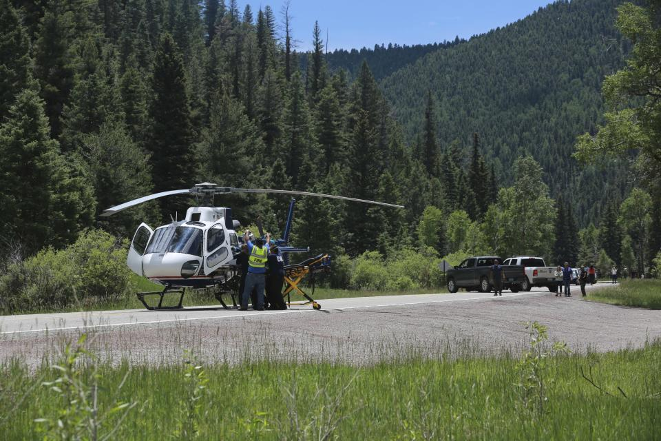 Medical staff transfer an elderly patient from a an ambulance to a helicopter on Friday, July 2, 2021, in the Carson National Forest, outside of Taos, N.M.. The man fell ill at a remote encampment as part of the annual Rainbow Gathering. More than 2,000 people have made the trek into the mountains of northern New Mexico as part of an annual counterculture gathering of the so-called Rainbow Family. While past congregations on national forest lands elsewhere have drawn as many as 20,000 people, this year's festival appears to be more reserved. Members (AP Photo/Cedar Attanasio)