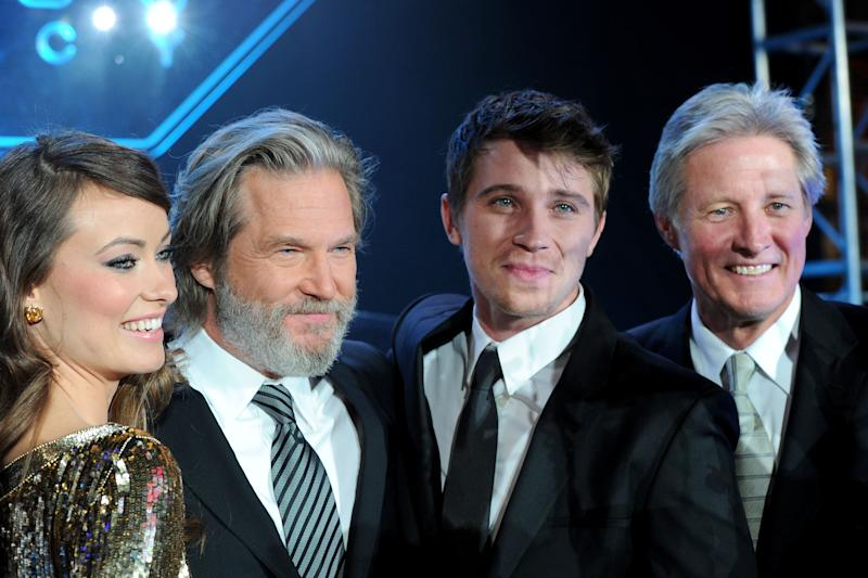 "LOS ANGELES, CA - DECEMBER 11: (L-R) Actors Olivia Wilde, Jeff Bridges, Garrett Hedlund and Bruce Boxleitner arrive at Walt Disney's ""TRON: Legacy"" World Premiere held at the El Capitan Theatre on December 11, 2010 in Los Angeles, California. (Photo by Alberto E. Rodriguez/WireImage)"