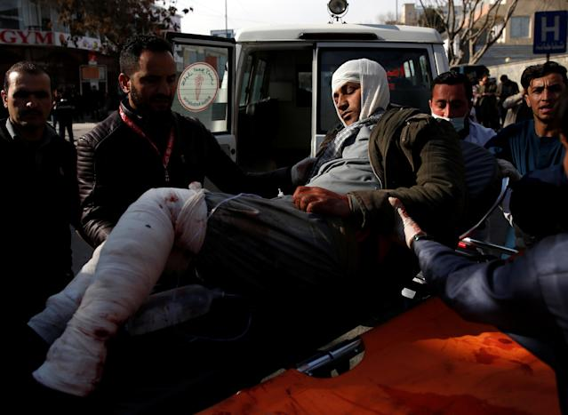 <p>An injured man is carried to the hospital after a blast in Kabul, Afghanistan, Jan. 27, 2018. (Photo: Mohammad Ismail/Reuters) </p>