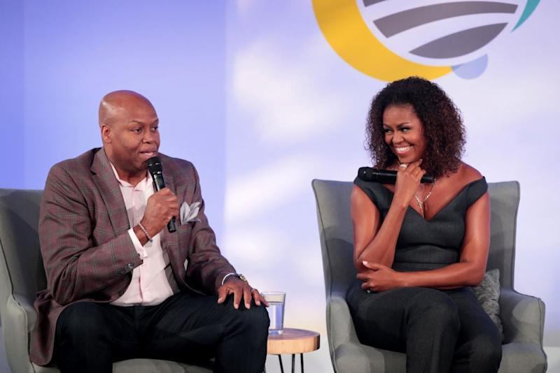 Michelle Obama (pictured in October 2019) hosts her brother Craig Robinson on her Spotify podcast (Getty Images)