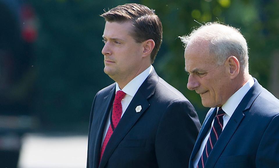 Rob Porter (left) lost his job as White House staff secretary after domestic violence accusations became public. (Photo: Saul Loeb/Getty Images)