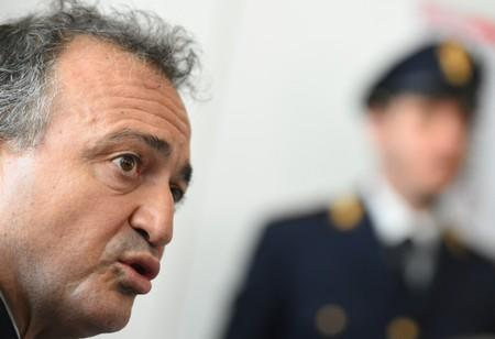 Head of the Palermo Police Operations Squad, Rodolfo Ruperti talks during a news conference after a coordinated crackdown with U.S. police against major crime families looking to rebuild their mafia powerbase in Palermo