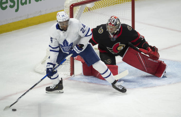 Toronto Maple Leafs right wing Wayne Simmonds controls the puck in front of Ottawa Senators goaltender Anton Forsberg during the first period of an NHL hockey game Wednesday, May 12, 2021, in Ottawa, Ontario. (Adrian Wyld/The Canadian Press via AP)