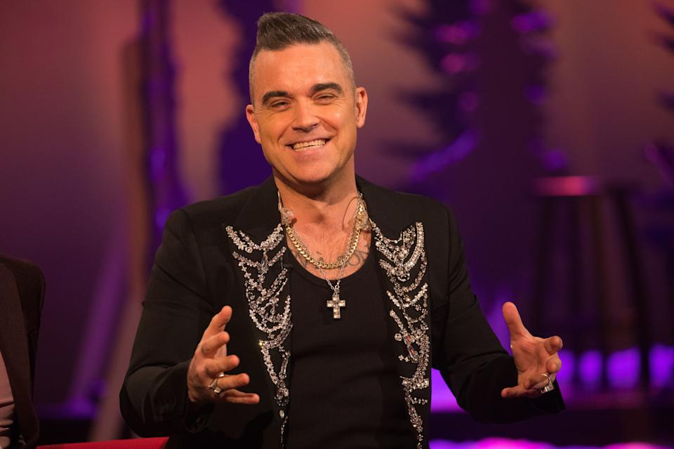 Robbie Williams during the filming for the Graham Norton Show at BBC Studioworks 6 Television Centre, Wood Lane, London, to be aired on BBC One on Friday evening. Picture date: Thursday December 19, 2019. Photo credit should read: PA Images on behalf of So TV