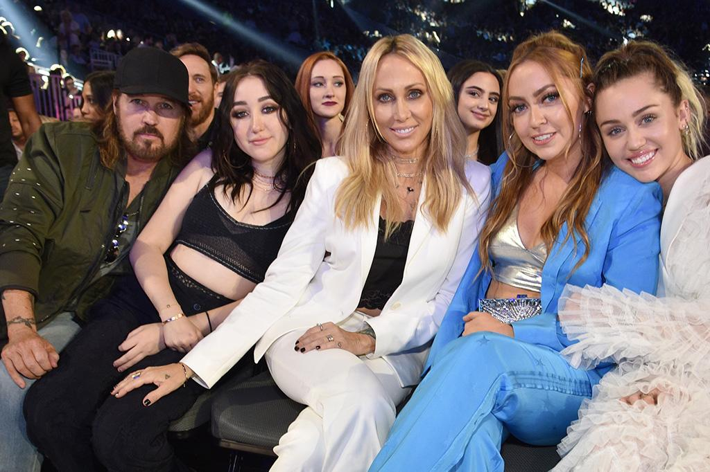 """<p>The fivesome was also front and center at the Billboard Music Awards on May 21. Miley was there to perform """"Malibu,"""" and she was introduced by Billy Ray and Noah, who quipped that her big sis was wearing pants """"for the first time in years."""" It was a big family moment, we guess. (Photo: Kevin Mazur/BBMA2017/Getty Images for dcp) </p>"""