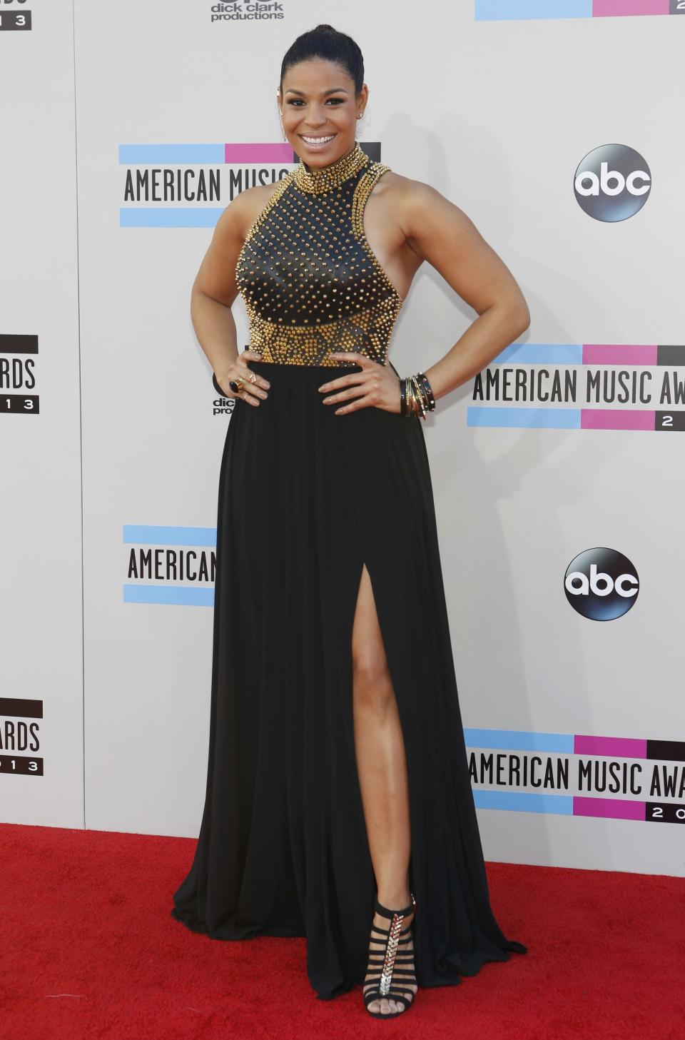 Jordin Sparks had a bit of a goddess vibe going tonight in this black dressed with flowing, split skirt and fitted, gold-studded top. The sandals complemented the look. We thought her hair could have used a bit more oomph, but overall, we approve. REUTERS/Mario Anzuoni (UNITED STATES- TAGS: ENTERTAINMENT)(AMA-ARRIVALS)