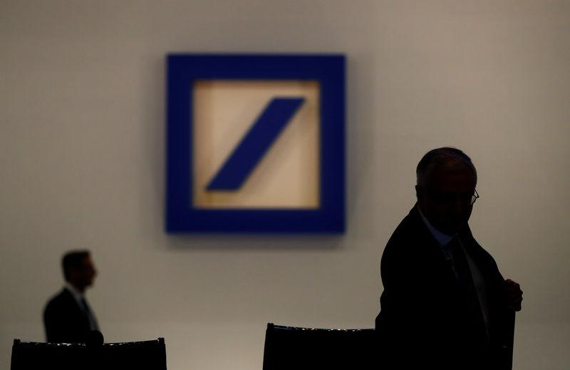 Deutsche Bank's Supervisory Board Chairman Paul Achleitner is silhouetted next to the Deutsche Bank's logo prior to the bank's annual meeting in Frankfurt