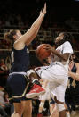 Stanford guard Lili Thompson, right, shoots against UC Davis forward Celia Marfone during the first half of an NCAA college basketball game in Stanford, Calif., Monday, Dec. 22, 2014. (AP Photo/Jeff Chiu)