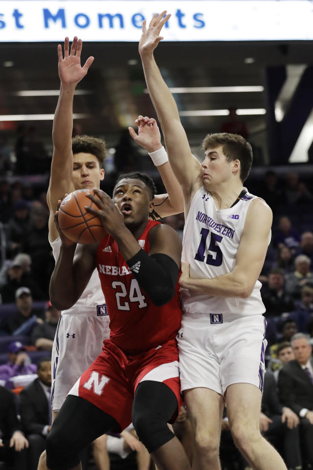Nebraska forward Yvan Ouedraogo, center, goes to the basket as Northwestern forward Pete Nance, left, and center Ryan Young guard against him during the first half of an NCAA college basketball game in Evanston, Ill., Saturday, Jan. 11, 2020. (AP Photo/Nam Y. Huh)