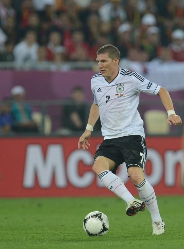 German midfielder Bastian Schweinsteiger controls the ball during  the Euro 2012 championships football match Germany vs Portugal  on June 9, 2012 at the Arena Lviv. AFP PHOTO / PATRIK STOLLARZPATRIK STOLLARZ/AFP/GettyImages