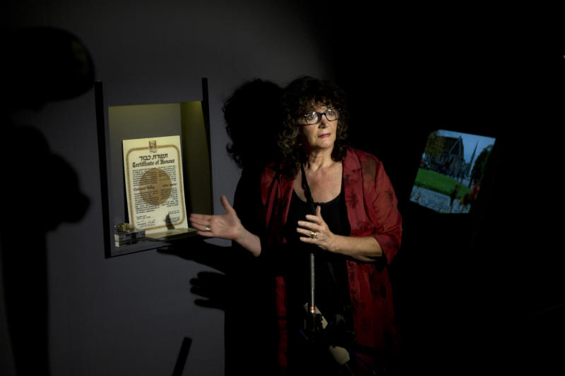 "Irena Steinfeldt, an official at Israel's Yad Vashem Holocaust memorial, shows a certificate recognizing Mohamed Helmy, an Egyptian physician in Berlin, as ""Righteous Among the Nations"" for saving a Jewish family during the Holocaust, in Jerusalem, Monday, Sept. 30, 2013. Israel's Holocaust memorial said it is posthumously honoring the Egyptian doctor who risked his life to rescue Jews during World War II, the first Arab ever to receive the prestigious award. (AP Photo/Sebastian Scheiner)"