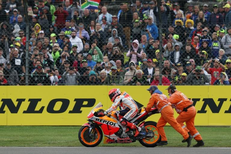 Push and shove: Honda's Marc Marquez endured an early end to the race (AFP/Adrian DENNIS)